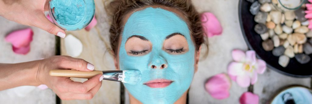 Beautiful woman at the spa wearing a facemask